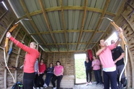 Archery action at the Swords Orthodontics team building event in June 2014