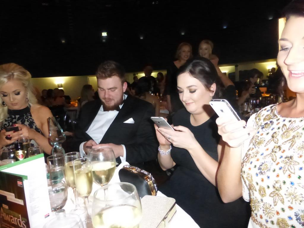 Team Swords Ortho all on their phones to spread the good news after their win at Irish Dentistry's Awards Ceremony